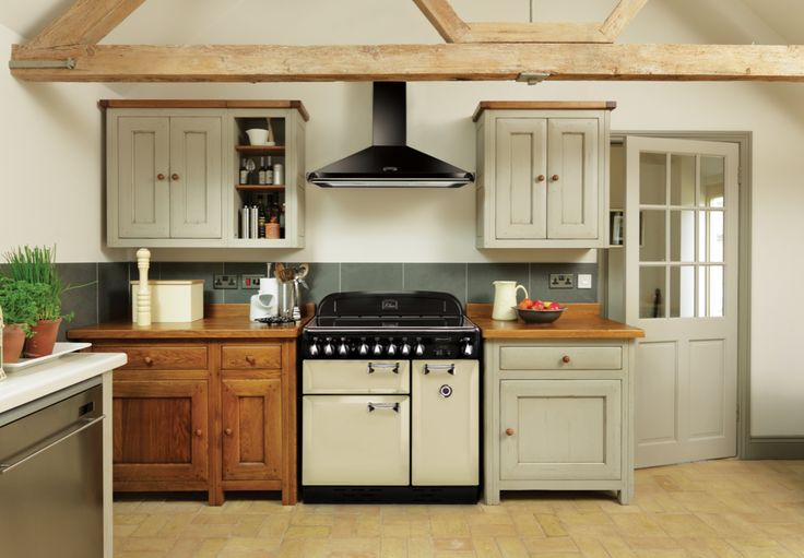 This Rangemaster Elan 90 range cooker looks perfect here in this rustic kitchen. The light olive and wooden units work well with this cream range cooker. The Rangemaster Elan is made by AGA Rangemaster in the UK. It uses the actual handles from an AGA and has a decorative thermostat feature on the tall oven door.