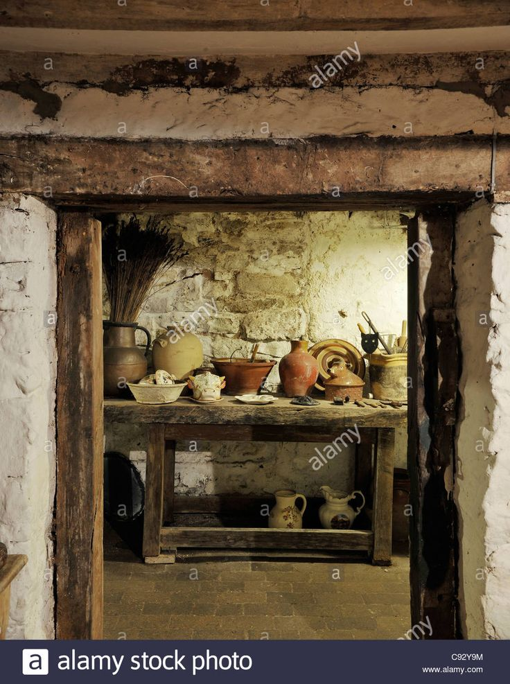 The cellars at Plas Teg offer visitors a wealth of kitchen history to explore with crockery and cookware dating back hundreds Stock Photo