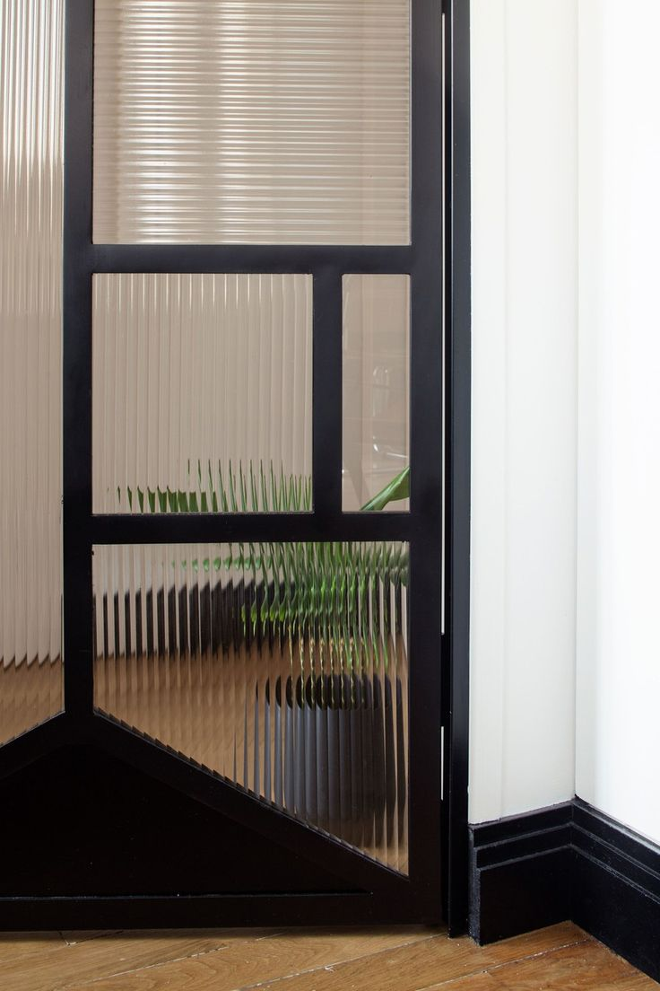 Reeded Glass Door In Paris Apartment