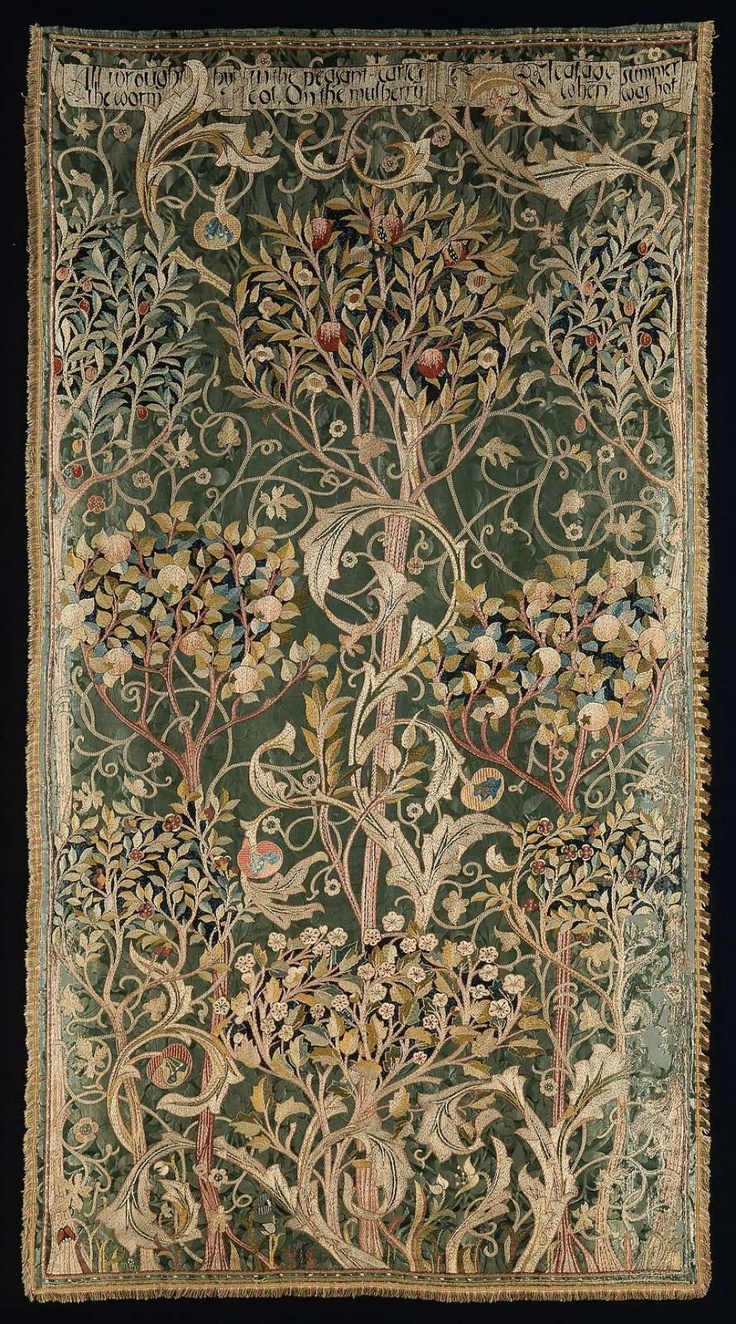 """""""Oak"""" Portière designed by William Morris for Morris & Co., 1880-1881. Signed """"MM"""" (May Morris). Silk yarns embroidered on green floral damask, with silk fringe & cotton lining. 8 long-trunk fruit trees bearing plums, pomegranates, apples, oranges, cherry blossoms; climbing vines. Inscription at top of panel: """"ALL WROUGHT BY THE WORM IN THE PHEASANT CARLE'S COT, ON THE MULBERRY LEAFAGE WHEN SUMMER WAS HOT"""" 1 of 4 panels. #William_Morris #May_Morris #Morris_and_Co #embroidery #portiere"""