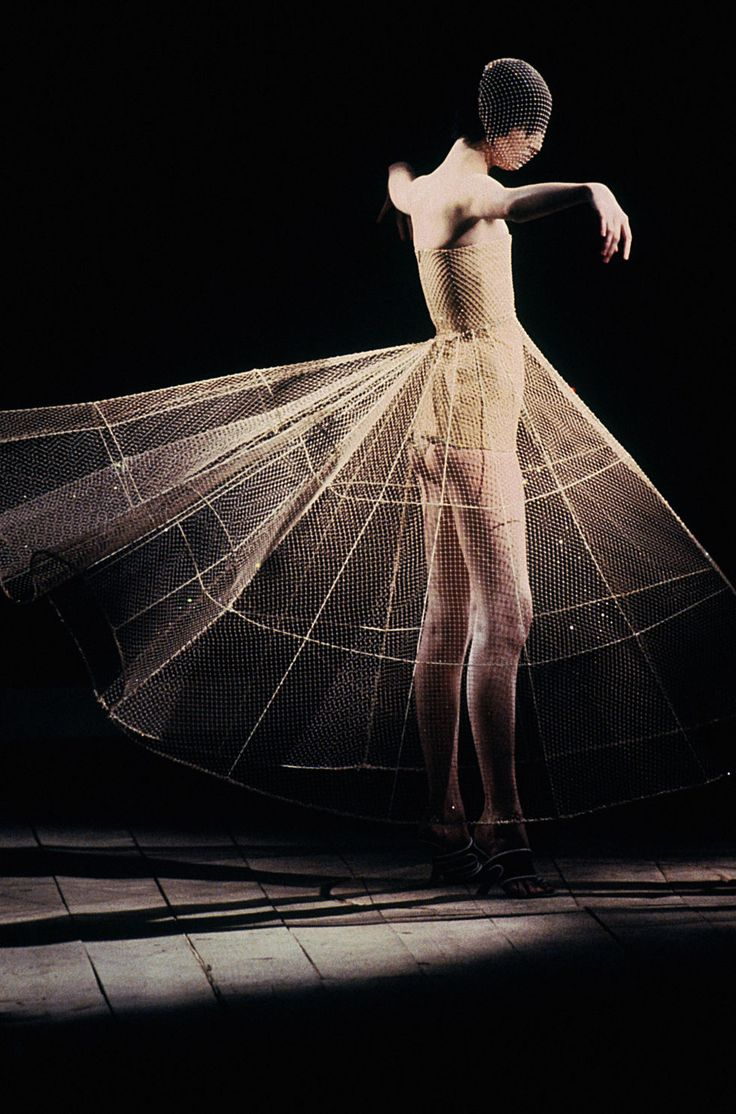 """Inside London's V&A exhibit """"Alexander McQueen: Savage Beauty,"""" which features more than 20 Swarovski crystal-embellished pieces by the late designer. See more images."""