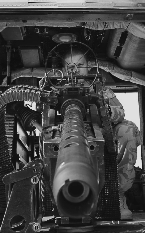 A .50 caliber machine gun defending the side of an American aircraft