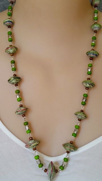 Multi coloured paper bead, green wooden bead and silver spacer bead necklace. $45.00
