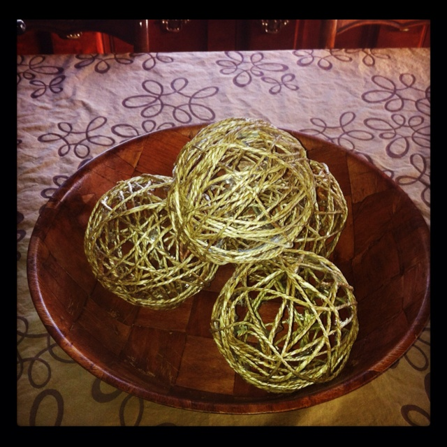 Easy homemade Yarn balls: will need yarn, balloons, modge podge, and scissors. 1. Blow balloons to desired size 2. Run yarn threw modge podge 3. Wrap saturated yarn around ballon to desired pattern. 4. Dry for 24 hours 5. Pop balloons carefully an remove remnants & decorate : ) they make great centerpieces
