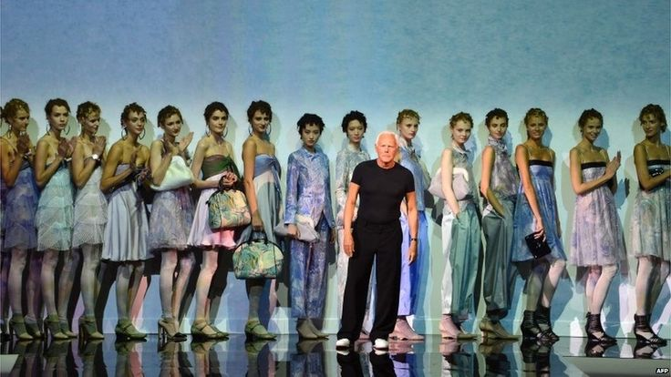 September 20, 2013. Models lined up behind Italian designer Giorgio Armani as he receives applause for his show at Milan's fashion week.