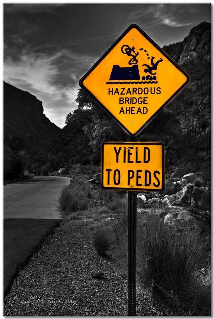 Yikes, not sure if the bridge is more worrying than the bike peeing on the cyclist   #funny #signs