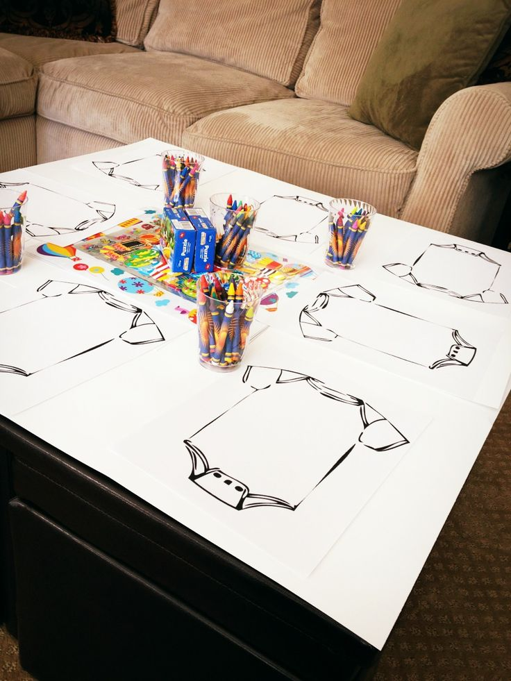 Toddler games table for a baby shower or baby sprinkle. Included: blank onesie printouts for decoration, crayons, stickers.