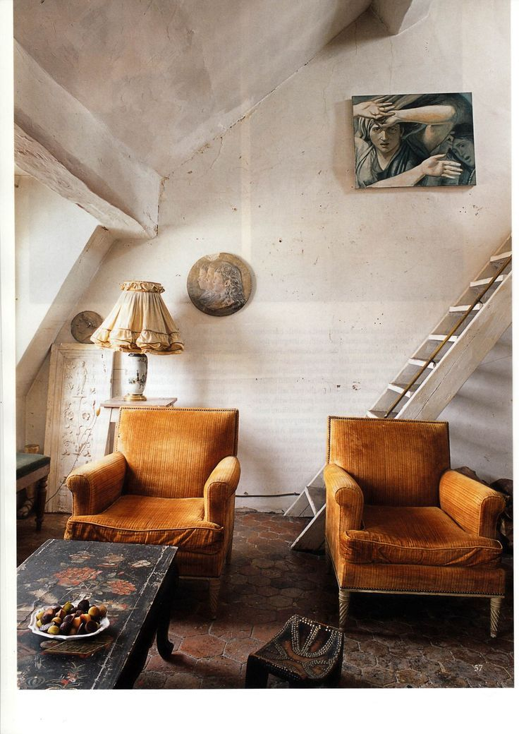 two vintage dark yellow chairs in the living room