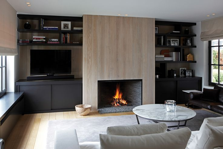 Love the sleek line built in, simple fireplace with wood surround( wood tiles? ) and the color scheme of the whole room.