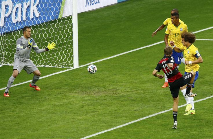 Germany's Thomas Mueller (13) scores against Brazil during their 2014 World Cup semi-finals at the Mineirao stadium in Belo Horizonte July 8...