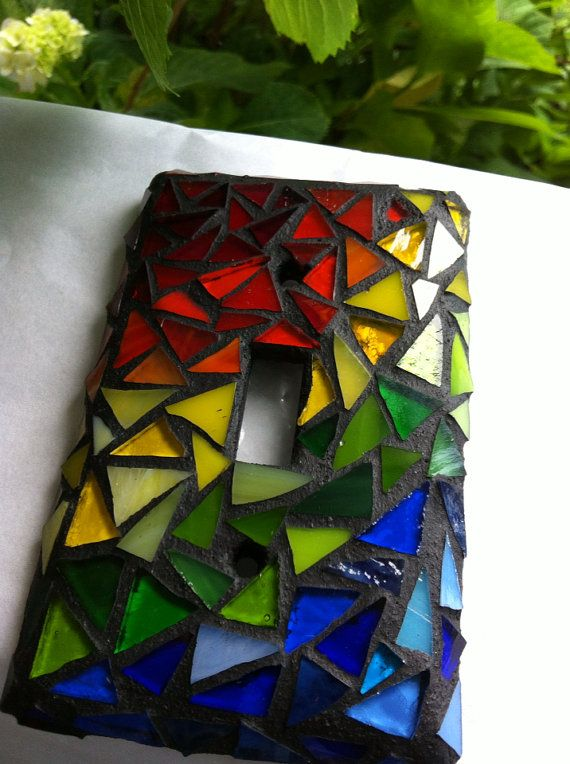 Add a rainbow to your walls! Bands of rainbow colored stained glass are hand cut and adhered to a standard single switch plate cover. This mini