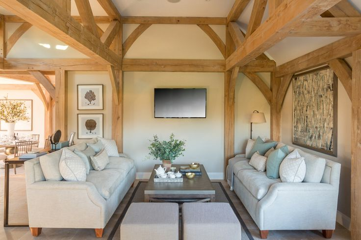 The gentle tones of ivory and muted teal enhance the light, airy design of our contemporary Surrey barn, amplified by these luxurious Romo Fabrics and Zoffany cushions.