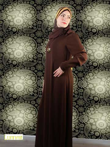 "Simple Abaya With Zipped Cuffs Just a simple solid color abaya made of super crepe, with narrow cuffs closed by zip . This would be a typical abaya that comply with Muslim dress code. Shayla (scarf) made of chiffon size 65cm x 175 cm / 25.6"" x 68.9"" .(optional) Washing Instructions: Machine Wash Tailored and designed by ""Lumar"""
