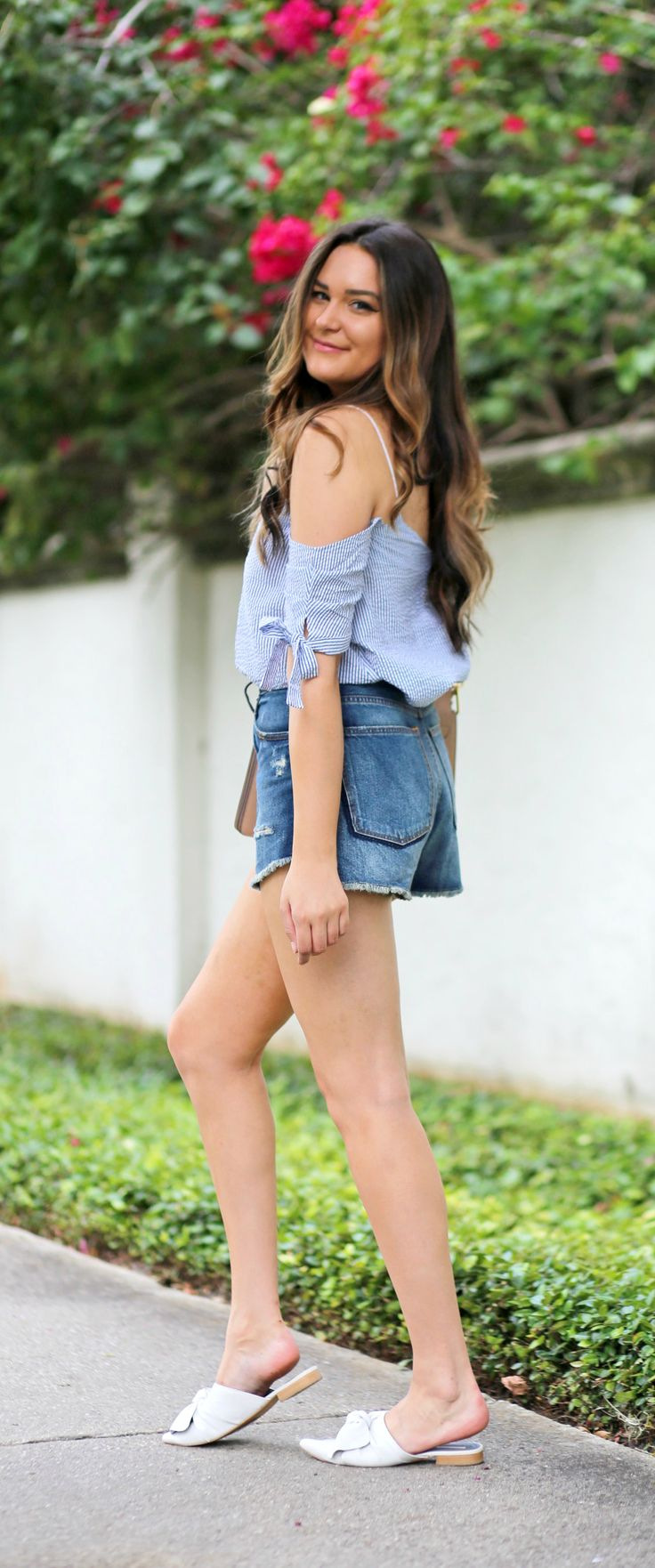 The bows on this top though!! | Fashion blogger Mash Elle styles a blue striped seersucker off the shoulder top from Urban Outfitters  with high waisted cut off ripped jeans short from Abercrombie and Fitch shorts, Michael Hill watch, and Chloe Faye purse.