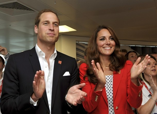 Britain's Prince William and Catherine, Duchess of Cambridge applaud the gold medal-winning performance by Britain's men's team pursuit track cyclists, during their visit to the Team GB headquarters in the Olympic Park in Stratford, east London during the London 2012 Olympic Games August 3, 2012.