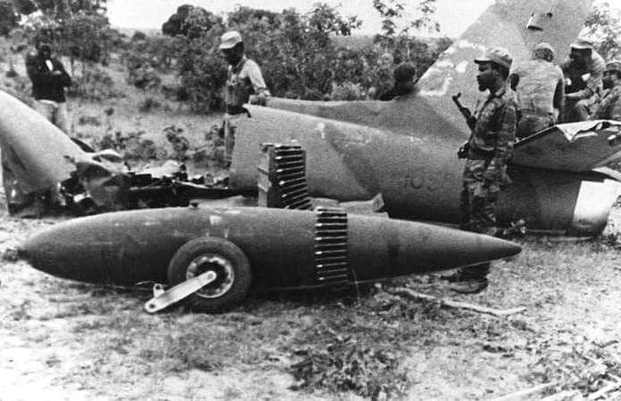 Angolan and Cuban soldiers inspect the wreckage of a South African ground attack aircraft that they've shot down. Precise date and exact location unknown.