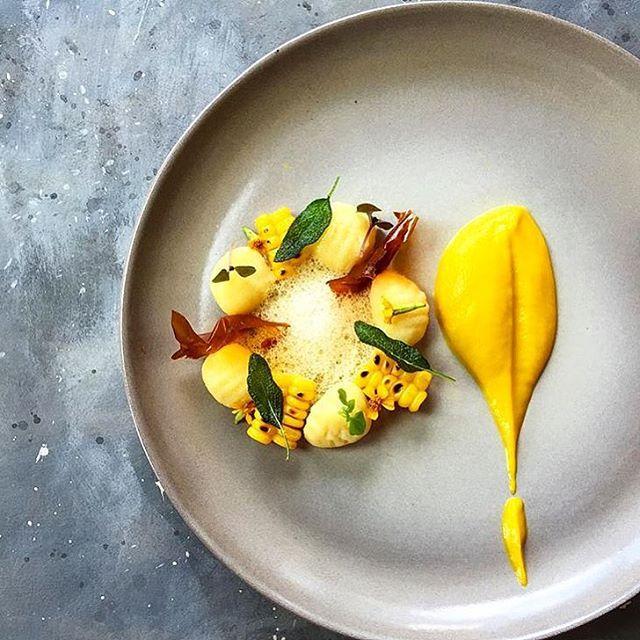 Gnocchi with charred corn, fried sage, pumpkin paper, tarragon flowers, saffron foam & pumpkin saffron sauce. Uploaded by @royalebrat #gastroart