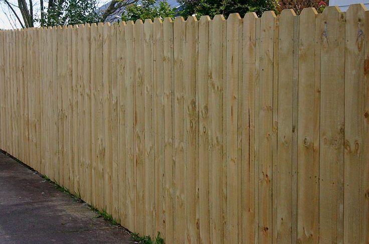 Dog eared plain board wooden fence
