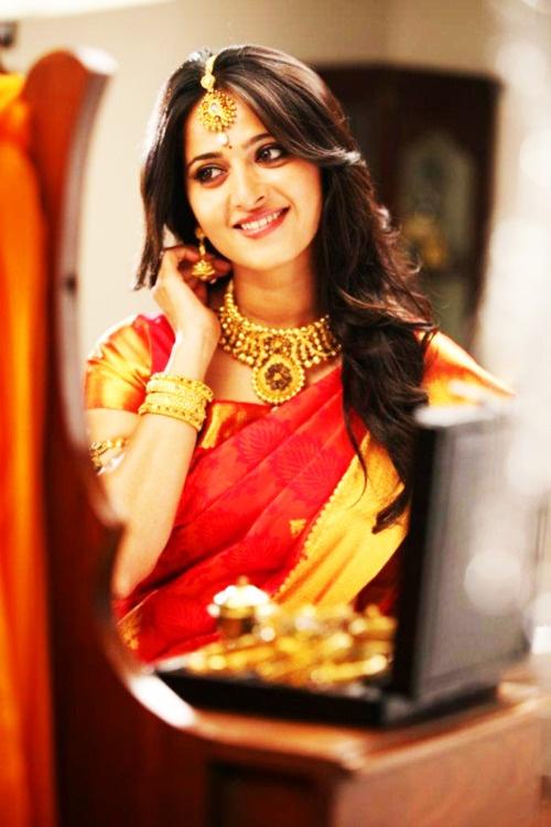 South Indian bride. Temple jewelry. Jhumkis.Red silk kanchipuram sari.Braid with fresh jasmine flowers. Tamil bride. Telugu bride. Kannada bride. Hindu bride. Malayalee bride.Kerala bride.South Indian wedding.Anushhka Shetty.