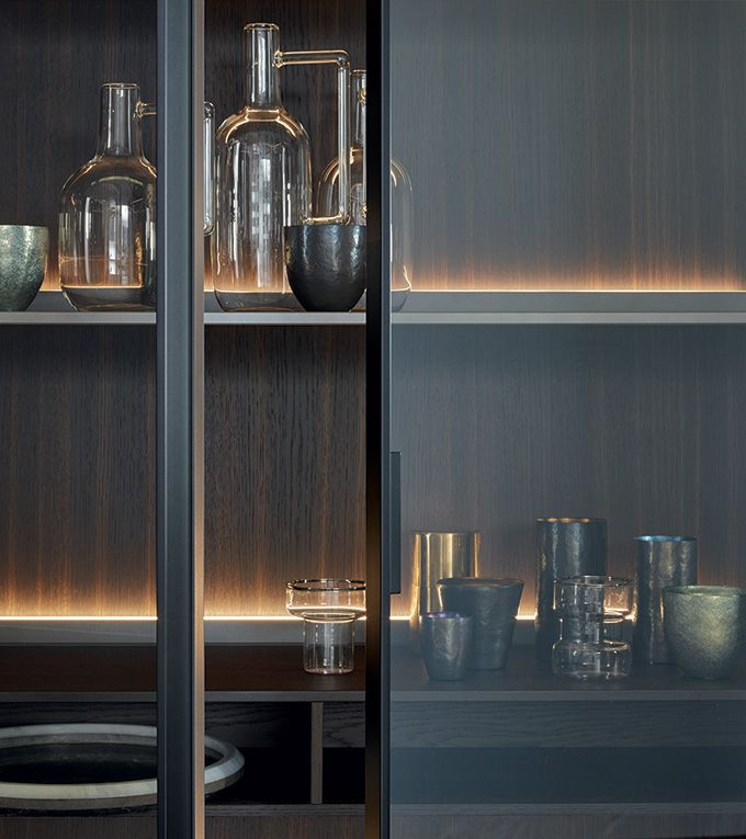 Pantry Wine Store - Similar to Walk in Robe Doors. Slimline bronze anodised door frames with smoked glass. Textured finish and concealed lighting.