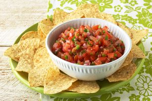 Fresh Tomato Salsa recipe - This super-simple recipe highlights the fresh ripe ingredients we love to eat with chips. A little heat from the jalapeño makes for an authentic Tex-Mex flavor.