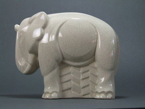 """Art Deco Modernist Elephant by Charles LEMANCEAU. This is the geometric stylised elephant which features on the cover of the """"Keramische Dieren"""" book. It is also shown inside on page 79. This one measures 9"""" long by 7"""" high (23cm x 17.5cm). Stamped France inside the base. Condition is very good with the usual tiny pin head nicks to the glaze as is usual for craquelier.  (hva)"""