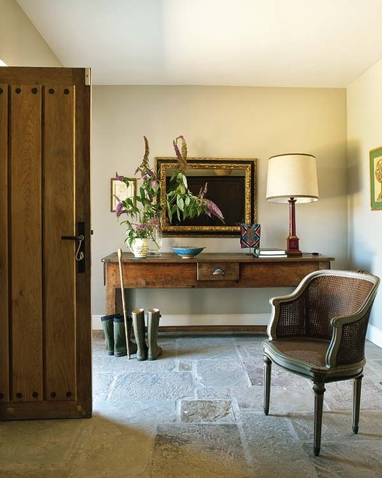 LOVE the entry with the rustic furniture