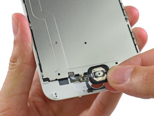 The home button assembly is secured by a metal bracket. Removing the bracket allows us to simply pop the home button off the front panel assembly.