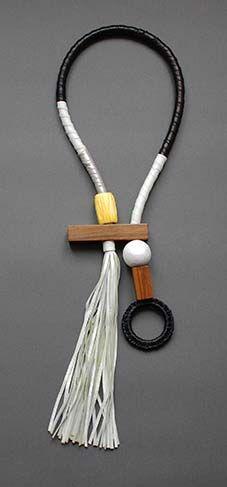 """CAPPIO"" neckpiece by Anna Maria Cardillo, leather, rafia, wood."