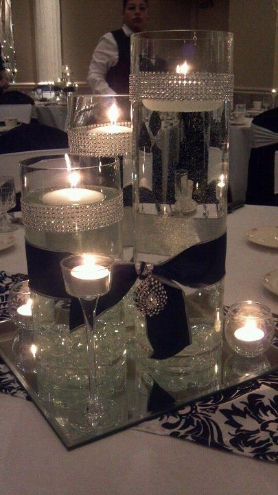 candles, crystals, rhinestones,satin, cylinder vases add gold ribbon, flowers, feathers