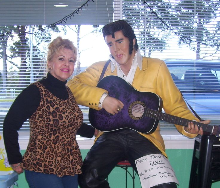 The sign says 'Please Don't Touch Elvis', Patricia Puddle! So why are you pinching his butt?