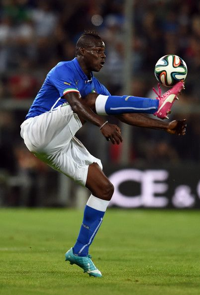 Mario Balotelli of Italy. The shoes stick out making me feel like you are trying to kiss or head the ball right off of you foot.