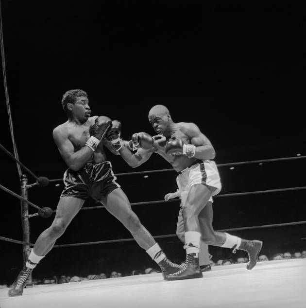 Rubin Carter Photo Gallery: Holly Mims (L) recoils from fury of middleweight contender Rubin (Hurricane) Carter during their bout at Madison Square Garden. Carter won a unanimous decision over Mims in the 4th round. Mims was a last minute substitute when Gomes Brennan became ill and had to withdraw. 1962