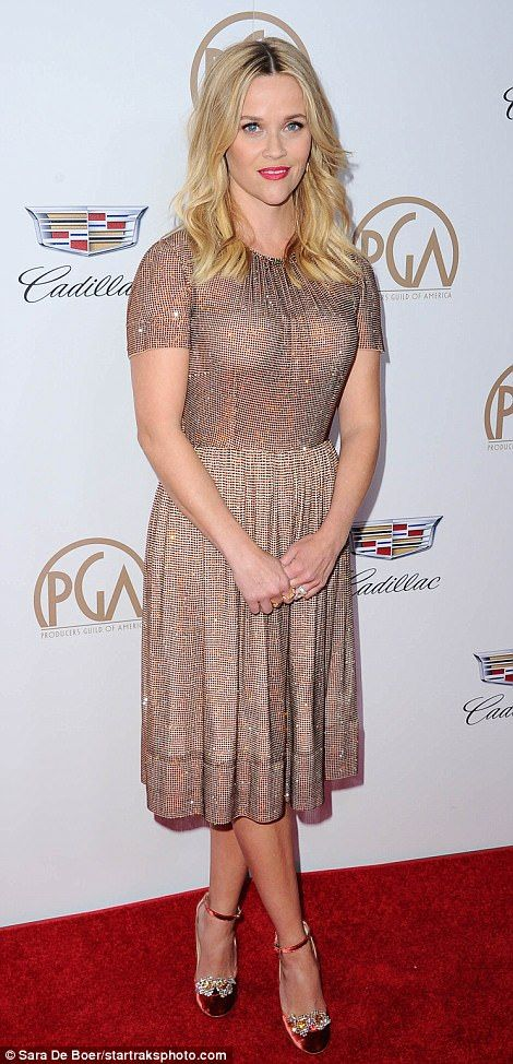 Fancy feet: Oscar-winning Witherspoon, 41; sparkled in a sheer nude short-sleeved creation...