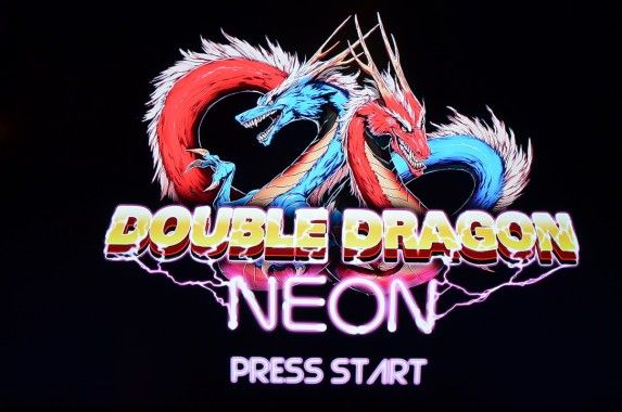 Due out this summer, Majesco and WayForward's Double Dragon Neon is looking to revitalize thefranchise with all of that classic flare and some brand new mechanics. Our very own MasterAbbottcaught up with Majesco Project Manager Pete Rosky at E3, who was ready to show off some more gameplayfrom an early build of the game.: Double Dragon, Pete Rosky, Majesco Project, Video Games, Manager Pete, Classic Flare, Masterabbott Caught