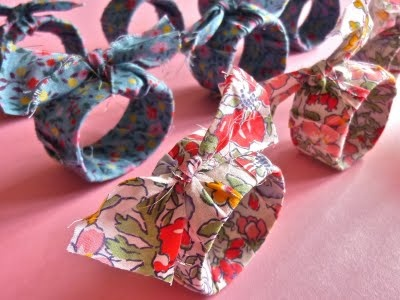 Fabric covered napkin rings made out of cardboard tubes and fabric.