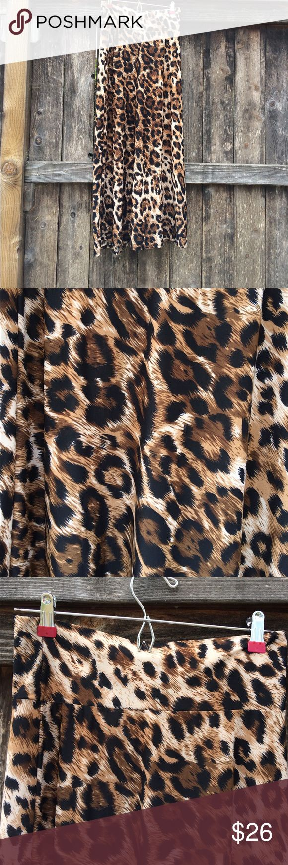 """Leopard Maxi Leopard Maxi skirt gently worn. Rayon spandex blend material so super light weight and silky like. Waist:13.5"""" unstretched, hips:18"""", and length: 40"""". Feel free to ask questions, I ship Same day! Skirts Maxi"""