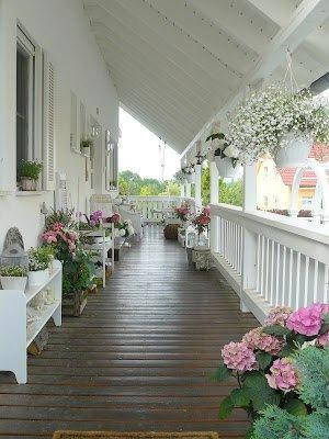 Wraparound #porch with pots planted in a pink, white and green color scheme is lovely! (uploaded image)