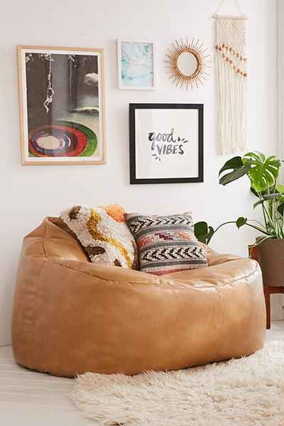 Oversized lounge chair made from recycled leather. Perfectly cushy + comfy design that works in any space!