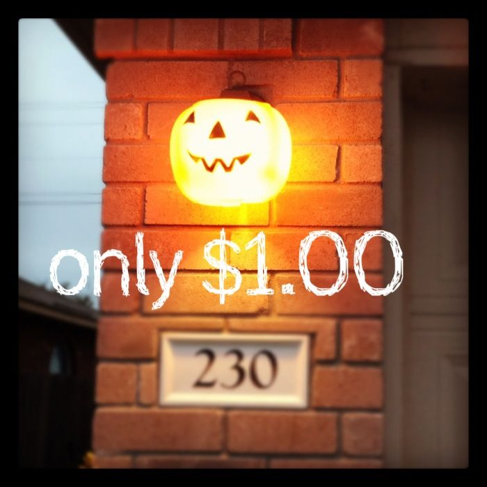 Buy a pumpkin trick-or-treat pail for $1.00, cut down the back, than cut out the bottom and wrap around your outside light! I also cut off the handle. Cheap, fast, and easy!