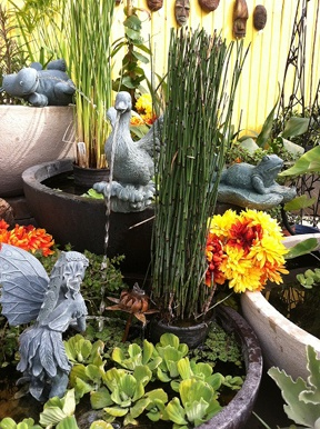 Check out this intricate container water garden display using Laguna Pond Spitters (http://www.lagunaponds.com/lagunaeng/ornamental/spitters.php?link=261) - Created by our friends at The Pond Digger, at their Exotic Waterscapes Headquarters in Yucaipa, CA.