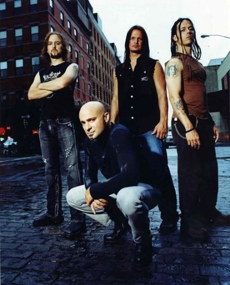 •Disturbed• (From left to right) - Mike Wengren (Drums) - David Draiman (Vocals) - Dan Donegan ( Guitar & Electronics) - John Moyer (Bass Guitar)