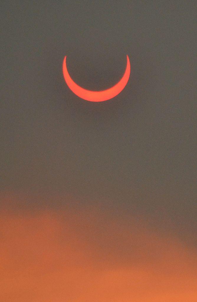 Annular eclipse seen through smoke from the Arizona wild fires, by Melissa McCollum