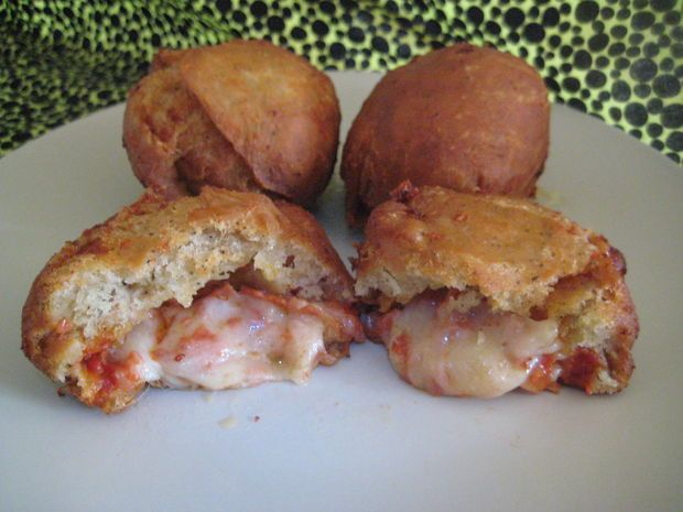 What could be better than pizza? Deep fried Mini Calzone balls with fluffy, yet crispy donut-like breading, That's what!
