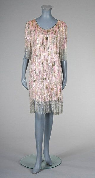 Yves Saint Laurent couture beaded and sequined cocktail dress, Spring-Summer, 1975, no 37502, the white organza ground smothered in pink and silver diamond-shaped paillettes interspersed with fringed streamers of crystal beads, integral ivory silk petticoat.