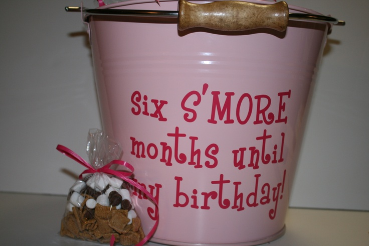 "half birthday snack 2012 - s'mores snack mix for each classmate (golden grahams, mini marshmallows, and chocolate chips), delivered in bucket that reads: ""six S'MORE months until my birthday"""