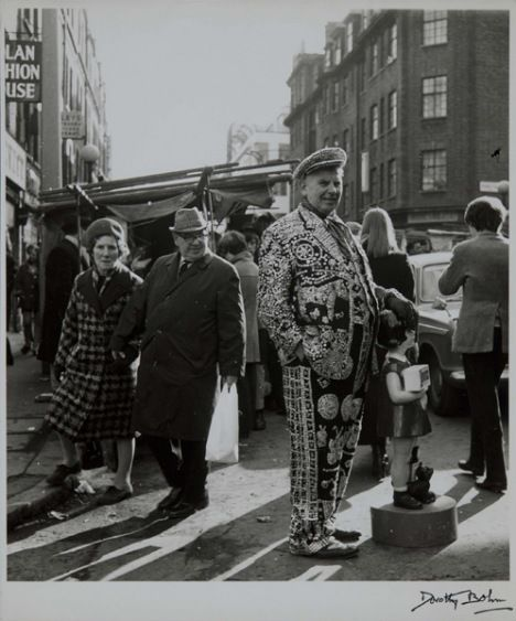 """Photography exhibition at the #Tate, International Photographers Capture City LIfe. Petticoat Lane Market, East End, London 1960s by Dorothy Bohm. I think this is a """"Pearly King"""""""