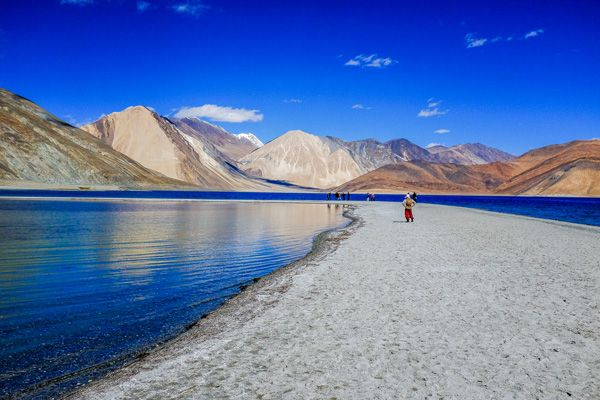 "Breathtaking Pangong Lake. Leh-Ladakh. India Pangong Tso, Tibetan for ""high grassland lake"", also referred to as Pangong Lake, is an endorheic lake in the Himalayas situated at a height of about 4,350 m. It is 134 km long and extends from India to China."