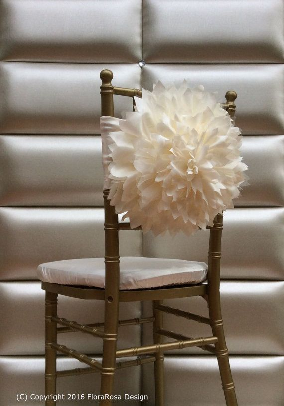 Ive created the flower using lots of layers of taffet,tulle making the flower look fully and gorgeous.  Our chair covers usually are fit on only the Chiavari chairs. If you are need another size,do not hesitate to contact us.  Avaliable for hire from a minimum of 30 items in the UK. Please do not hesitate to ask for prices.