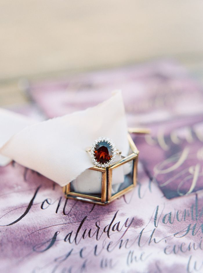 Vintage Ruby Engagement Ring with a Diamond Halo